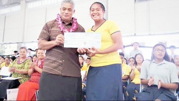 Health Department director Motusa Tuileama Nua (left) accepting donation from Georgina Alofa