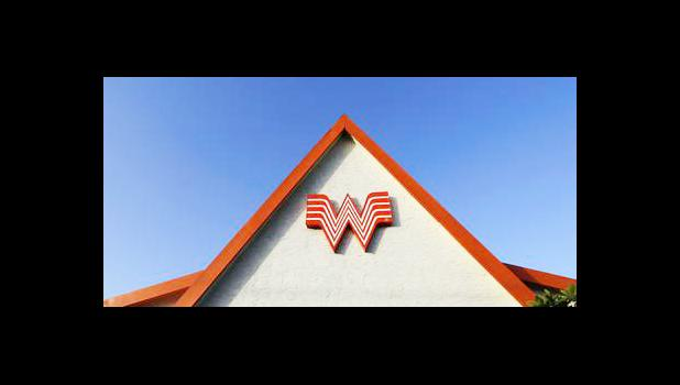 This Thursday, July 9, 2015, file photo shows a Whataburger restaurant in San Antonio, Texas. The Texas restaurant chain said on social media Wednesday, June 28, 2017, that a story shared online that claims it would be going out of business on Aug. 1 is a hoax. (AP Photo/Eric Gay, File)