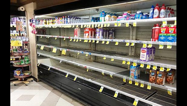 empty shelves in a Eva Beach store, Honolulu