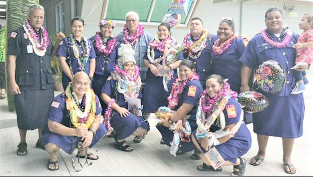 The 11 graduates and EMS head Popo Avegalio
