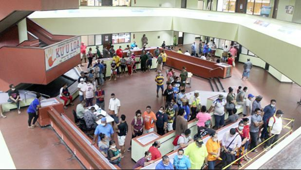 A view of the atrium at the EOB crowded with people