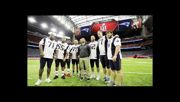 New England Patriots players pose for a photo during a walk through at NRG Stadium, site of the NFL Super Bowl 51 football game, Saturday, Feb. 4, 2017, in Houston. The Patriots will face the Atlanta Falcons in the Super Bowl Sunday. (AP Photo/Charlie Riedel)