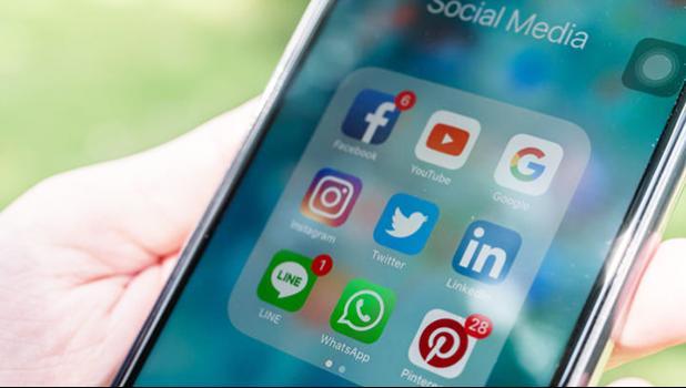 Social media apps, including Facebook, on face of smart phone