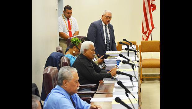 Four representatives at their desks