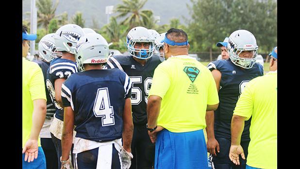 Samoana Sharks head coach, Pati Pati giving advice to his defensive unit