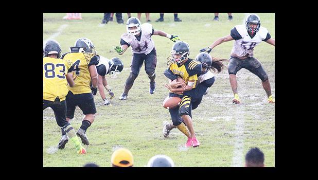 Tafuna's middle linebacker – Penei Pavihi, causing a fumble in the first half of their varsity battle last Saturday, hits Nu'uuli Voc-Tech's Hans Misa hard. Tafuna defeated Nu'uuli 36 - 6. [photo: TG]
