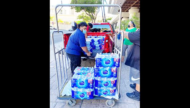 Cases of water on a dolly