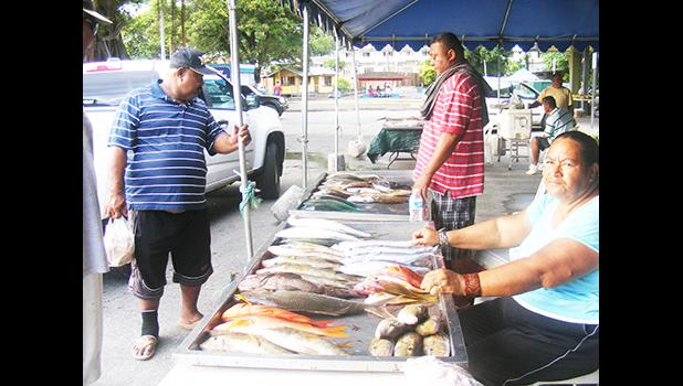 A woman selling fish at the Fagatogo Marketplace in 2016