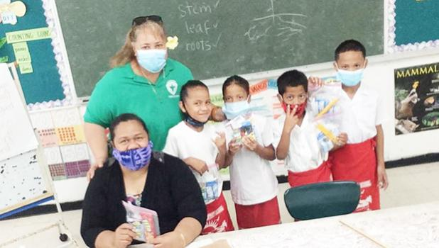 First grade students at Fitiuta hold up gifts