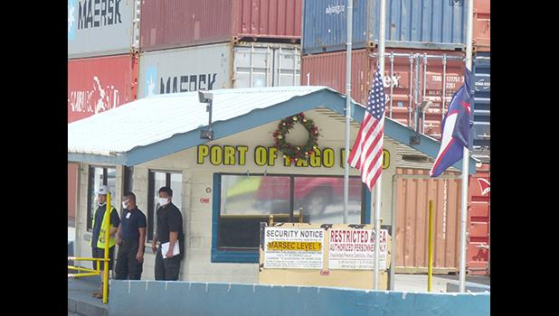 Flags lowered at entrance to port