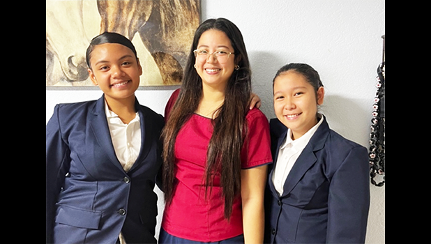 Talalelei Roberts (left) and Princess Viesca (right) joined by their HOSA advisor, Ms Cassandra Garcia (middle).
