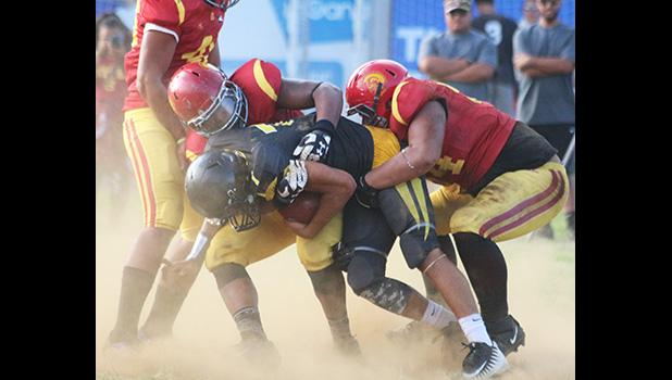 Nu'uuli Wildcats quarterback Nathaniel Maea is swallowed in the backfield for a loss by