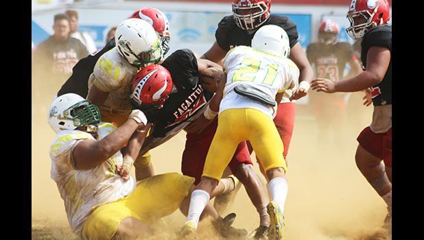 Leone Lions' beastly defensive lineman Cyan Fiatoa and his teammates bringing down Joseph Umu