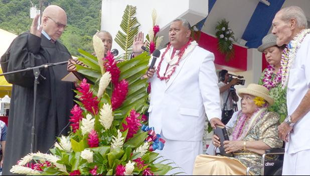 Chief Justice Lealaialoa Michael Kruse (far left) presides over the swearing in of the new governor, Lemanu Peleti Palepoi Sialega Mauga (third from left)