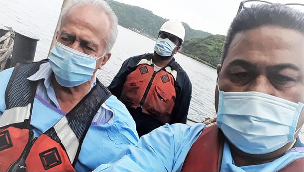 Harbor Master Silila Patane (left), Health official John Fuimaono (right) unnamed man in background