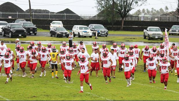 Faga'itua Vikings Football Team running towards the sidelines