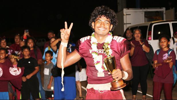 Metuliki Tupou flashing a V for victory