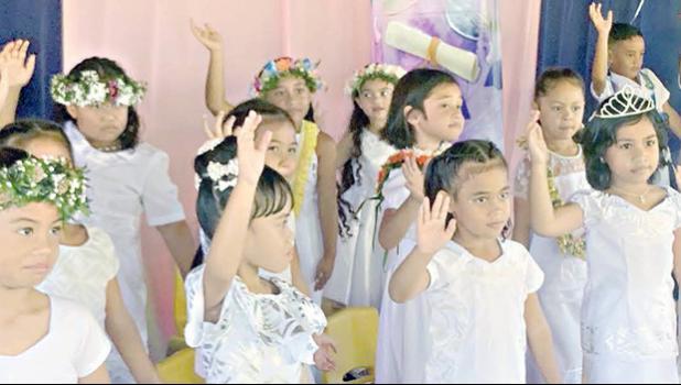 Some members of  K-5 Fatuoaiga Montessori School performing at their graduation ceremony