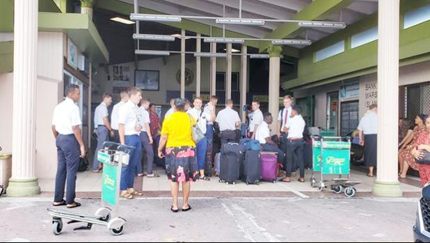 LDS church missionaries at Majuro airport