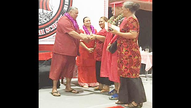 Gov Lemanu and First Lady Ella with others on stage at Faga'itua graduation