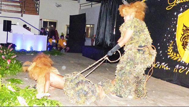 Two students dressed as lions