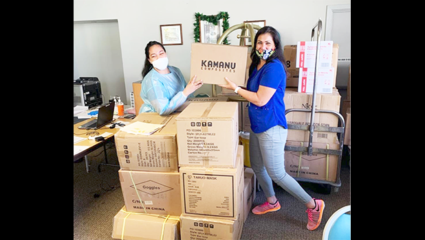 Two women receiving donated items in boxes