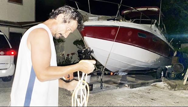 Harry Calistro Jr, ties down his 27' fishing boat
