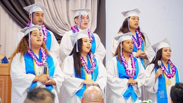 Seven of the eight Manumalo graduates