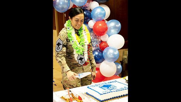 Chief Master Sergeant Jacinta Migo cutting her cake