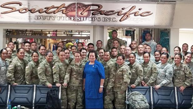 Amata with troops at airport