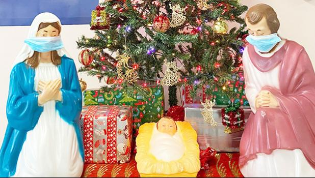 Nativity Scene in front of a Christmas Tree