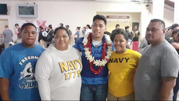 John Leulu with his parents and siblings