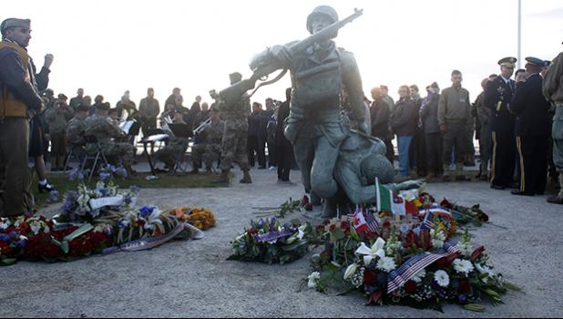 Floral tributes are placed at the National Guard Monument Memorial