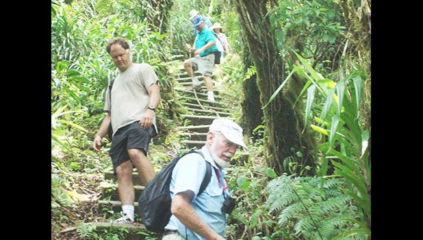 This undated photo provided by the National Park of American Samoa, shows visitors enjoying themselves at one of the park trails.