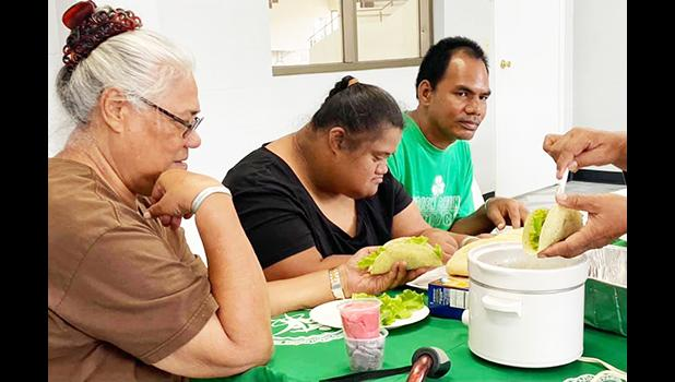 Parents with their special needs children learning how to make tacos