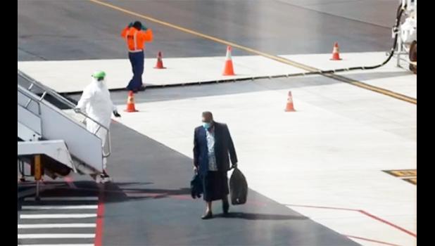 Passenger getting off Air New Zealand plane