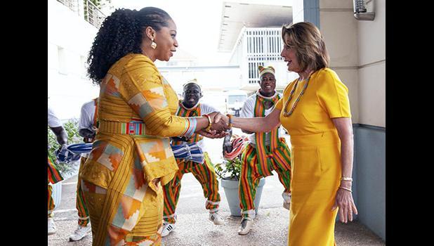 U.S. House Speaker Rep. Nancy Pelosi, D-Calif., shakes hands with the Hon. Sarah Adwoa Sarfo outside Ghana's Parliament
