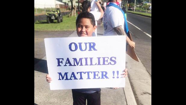 Young demonsrator at Saturday's rally for stranded residents.