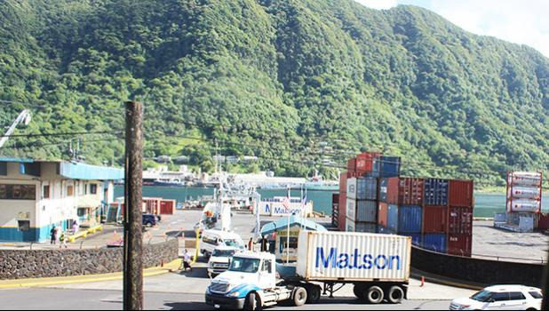 Vehicles streaming out of Port of Pago Pago after tsunami warning issued