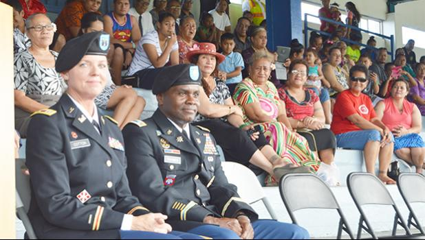 US Army Recruiting Commanders, Capt. Carneen Cotton (left) and Maj. Ulisses Tymes with parents, families and friends who witnessed the swearing-in of 31 of the 80 DEP enlistees as future US Army soldiers at the Veterans Memorial Stadium on Wednesday afternoon.  [photo: AF]