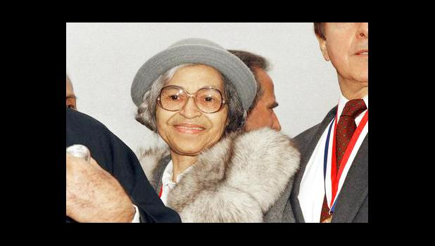 This Oct. 28, 1986, file photo shows Rosa Parks at Ellis Island in New York. The AP reported on Aug. 25, 2017, that a story circulating online that Parks' daughter praised President Donald Trump's response to violence in Charlottesville, Va. is false. Parks didn't have any children. (AP Photo, File)