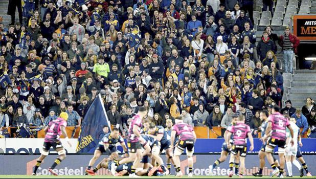 Rugby match in New Zealand with fans in the stands