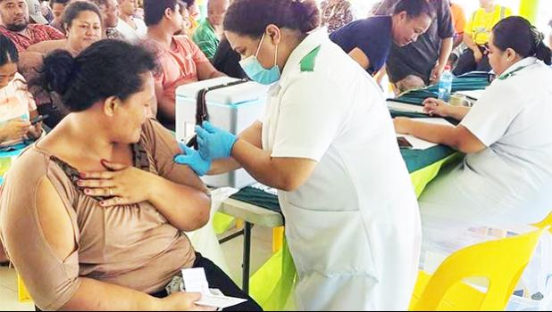 People getting vaccinated in Samoa during a vaccination drive