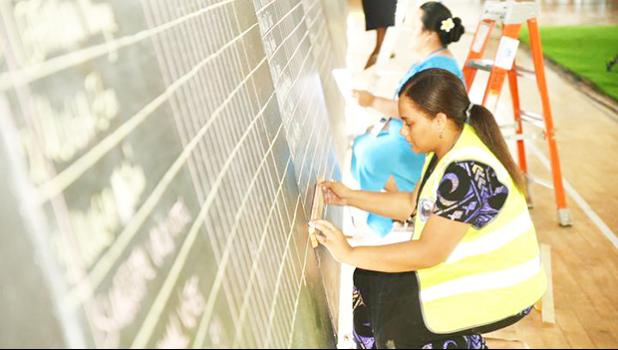 Samoa votes being tallied by young woman at blackboard