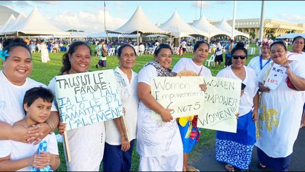 women with signs supporting an additional slot for women in parliament