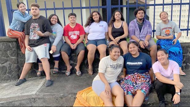 Some Samoana high school seniors waiting to take part in their photo shoot outside the Lee Auditorium.