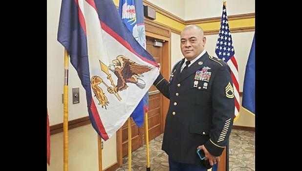 SFC Samasoni Lele'a with the American Samoa flag