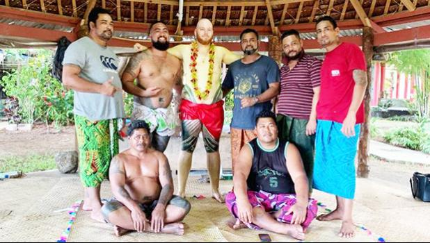 So'omalo Iteni Schwalger in Samoa with others after his tatau was done.