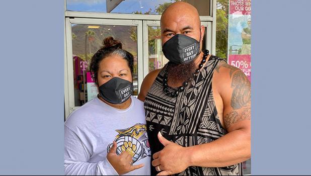 Isaac and Mrs Sopoaga with protective masks on