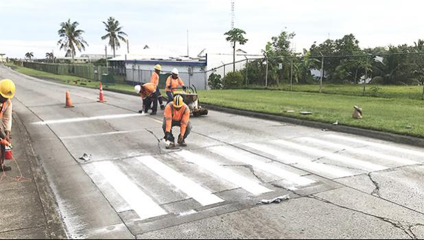 McDow workers completing crosswalk stripping at South Pacific Academy